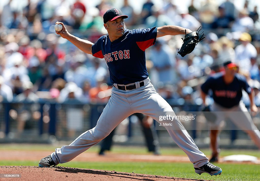 Pitcher Alfredo Aceves #91 of the Boston Red Sox pitches against the Tampa Bay Rays during a Grapefruit League Spring Training Game at the Charlotte Sports Complex on March 16, 2013 in Port Charlotte, Florida.