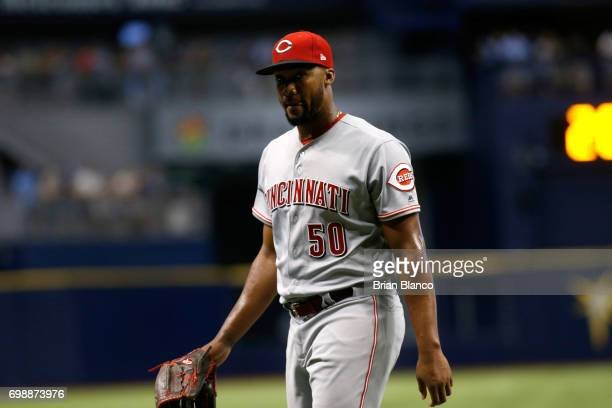 Pitcher Amir Garrett of the Cincinnati Reds makes his way to the dugout after being taken off the mound by manager Bryan Price during the fourth...