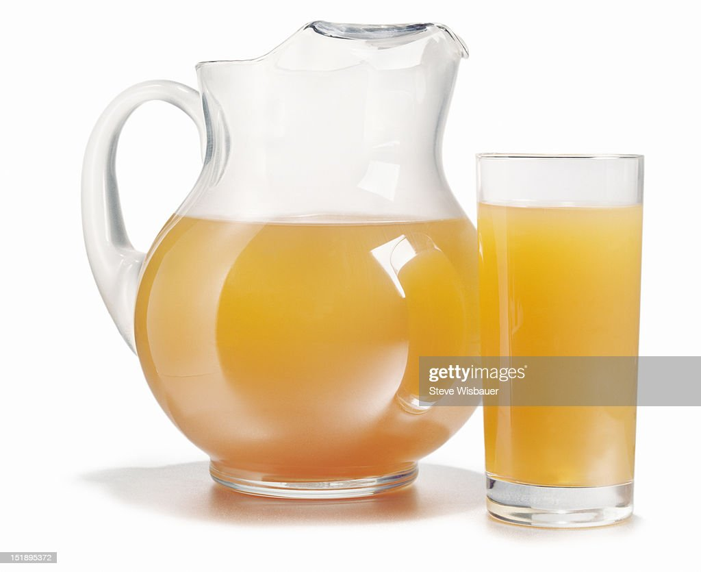 Pitcher and glass full of fresh orange juice
