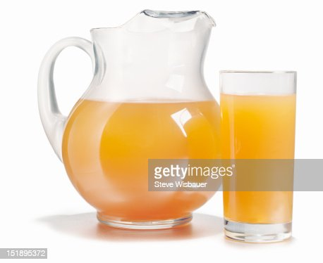 Pitcher and glass full of fresh orange juice