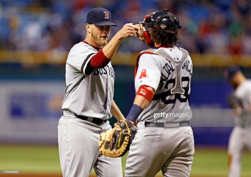 Pitcher Andrew Bailey #40 of the Boston Red Sox celebrates his save with catcher <a gi-track='captionPersonalityLinkClicked' href=/galleries/search?phrase=Jarrod+Saltalamacchia&family=editorial&specificpeople=836404 ng-click='$event.stopPropagation()'>Jarrod Saltalamacchia</a> #39 over the Tampa Bay Rays at Tropicana Field on June 12, 2013 in St. Petersburg, Florida.