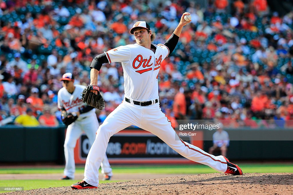 Pitcher <a gi-track='captionPersonalityLinkClicked' href=/galleries/search?phrase=Andrew+Miller+-+Baseball+Player&family=editorial&specificpeople=4496823 ng-click='$event.stopPropagation()'>Andrew Miller</a> #48 of the Baltimore Orioles throws to a St. Louis Cardinals batter at Oriole Park at Camden Yards on August 10, 2014 in Baltimore, Maryland.