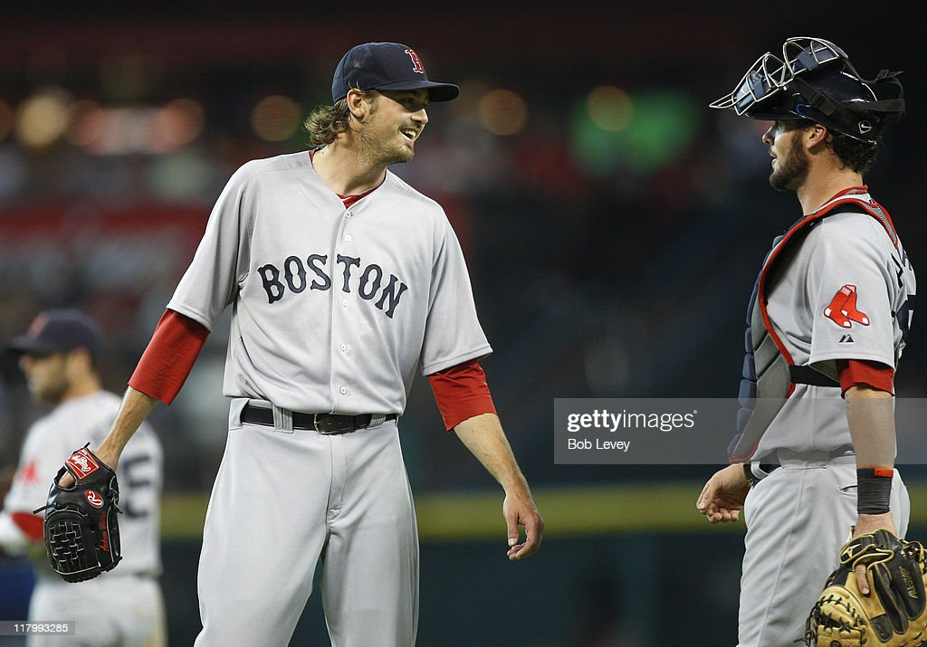 Pitcher <a gi-track='captionPersonalityLinkClicked' href=/galleries/search?phrase=Andrew+Miller+-+Baseball+Player&family=editorial&specificpeople=4496823 ng-click='$event.stopPropagation()'>Andrew Miller</a> #30 of the Boston Red Sox laughs with catcher <a gi-track='captionPersonalityLinkClicked' href=/galleries/search?phrase=Jarrod+Saltalamacchia&family=editorial&specificpeople=836404 ng-click='$event.stopPropagation()'>Jarrod Saltalamacchia</a> #39 after he was hit with a ball during a baseball game against the Houston Astros at Minute Maid Park on July 2, 2011 in Houston, Texas.