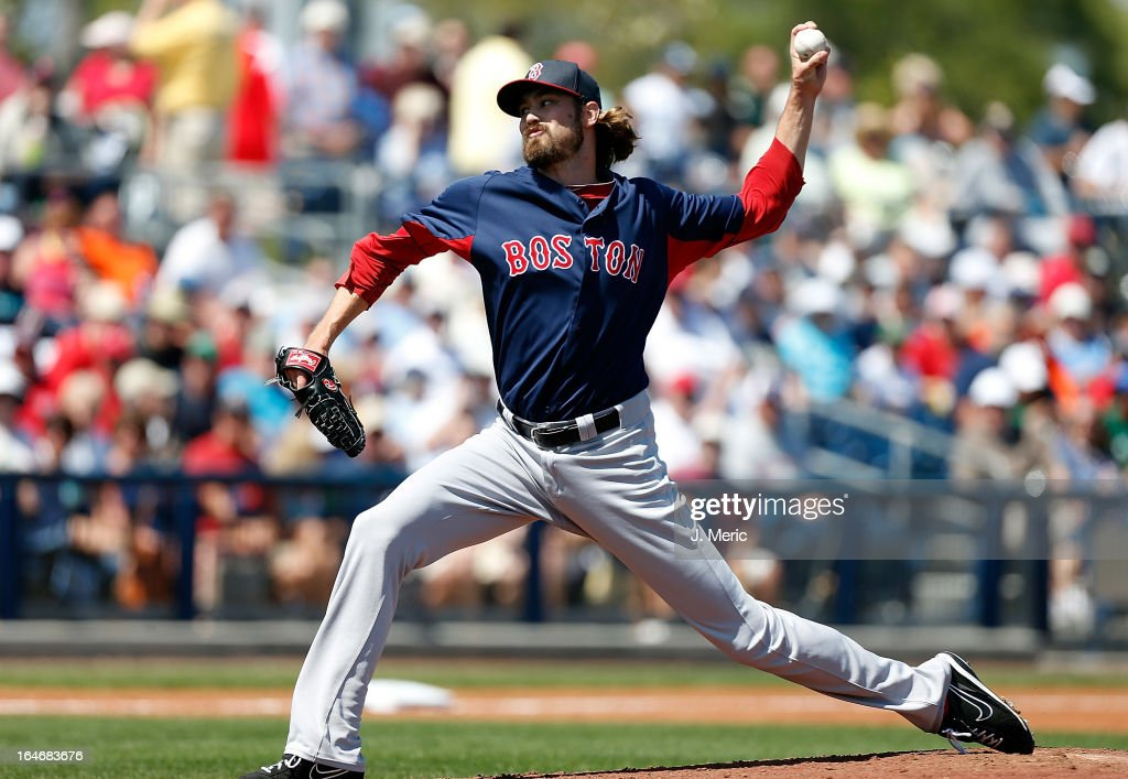 Pitcher Andrew Miller #30 of the Boston Red Sox pitches against the Tampa Bay Rays during a Grapefruit League Spring Training Game at the Charlotte Sports Complex on March 16, 2013 in Port Charlotte, Florida.