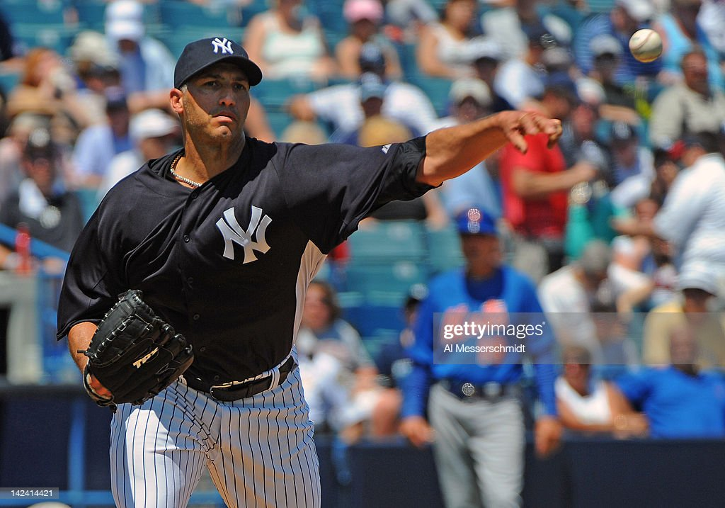 Pitcher <a gi-track='captionPersonalityLinkClicked' href=/galleries/search?phrase=Andy+Pettitte&family=editorial&specificpeople=201753 ng-click='$event.stopPropagation()'>Andy Pettitte</a> #46 of the New York Yankees attempts a pickoff against the New York Mets in a spring training game April 4, 2012 at George M. Steinbrenner Field in Tampa, Florida. Pettitte last pitched in 2010.