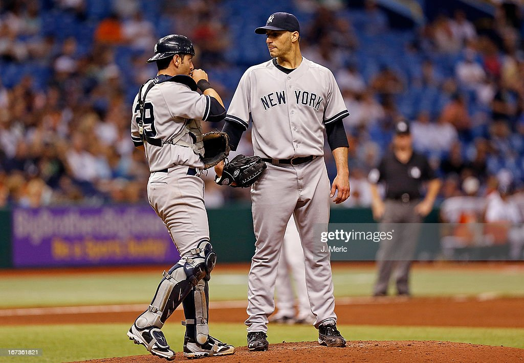Pitcher <a gi-track='captionPersonalityLinkClicked' href=/galleries/search?phrase=Andy+Pettitte&family=editorial&specificpeople=201753 ng-click='$event.stopPropagation()'>Andy Pettitte</a> #46 of the New York Yankees talks wtih catcher <a gi-track='captionPersonalityLinkClicked' href=/galleries/search?phrase=Francisco+Cervelli&family=editorial&specificpeople=4172506 ng-click='$event.stopPropagation()'>Francisco Cervelli</a> #29 during the fifth inning against of the Tampa Bay Rays at Tropicana Field on April 24, 2013 in St. Petersburg, Florida.