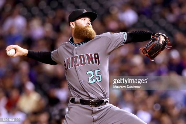 Pitcher Archie Bradley of the Arizona Diamondbacks throws in the eighth inning against the Colorado Rockeis at Coors Field on May 5 2017 in Denver...