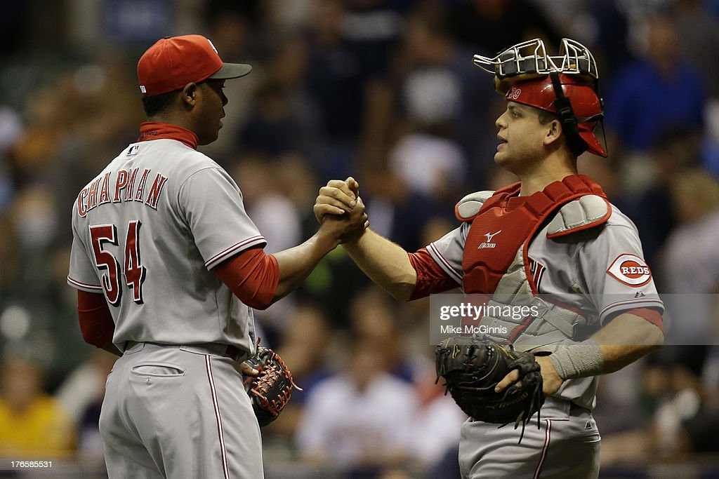 Pitcher <a gi-track='captionPersonalityLinkClicked' href=/galleries/search?phrase=Aroldis+Chapman&family=editorial&specificpeople=5753195 ng-click='$event.stopPropagation()'>Aroldis Chapman</a> #54 of the Cincinnati Reds celebrates with catcher <a gi-track='captionPersonalityLinkClicked' href=/galleries/search?phrase=Devin+Mesoraco&family=editorial&specificpeople=5745587 ng-click='$event.stopPropagation()'>Devin Mesoraco</a> #39 after the 2-1 win over the Milwaukee Brewers at Miller Park on August 15, 2013 in Milwaukee, Wisconsin.