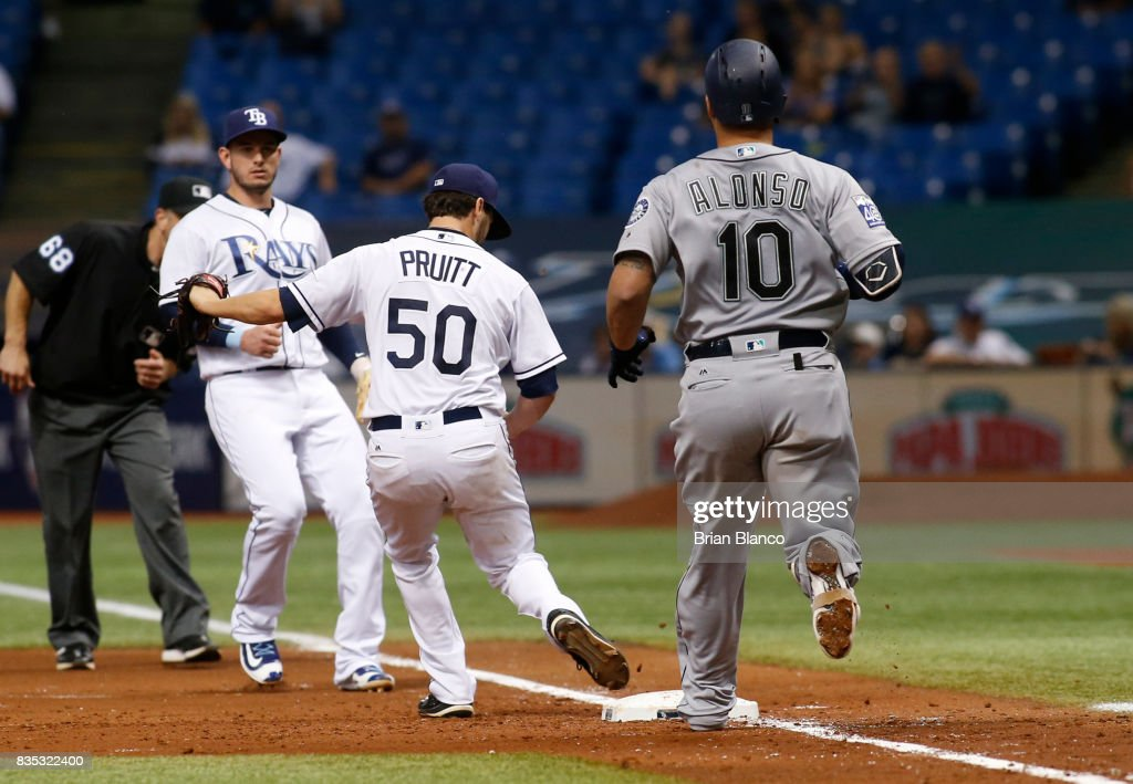 Pitcher Austin Pruitt #50 of the Tampa Bay Rays gets the out at first base on Yonder Alonso #10 of the Seattle Mariners to complete the double play to end the top of the fourth inning of a game on August 18, 2017 at Tropicana Field in St. Petersburg, Florida.