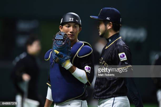 Pitcher Ayumu Ishikawa and Catcher Seiji Kobayashi of Japan talk after the bottom of the fifth inning during the SAMURAI JAPAN Sendoff Friendly Match...