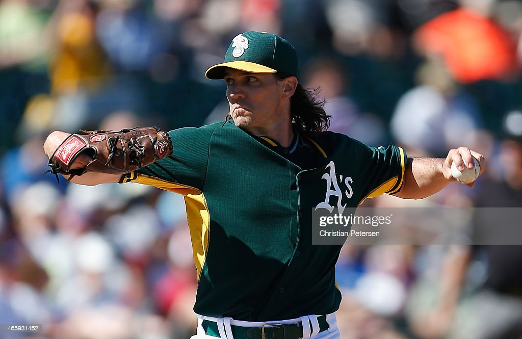 Pitcher Barry Zito of the Oakland Athletics pitches against the Arizona Diamondbacks during the spring training game at HoHoKam Stadium on March 10...