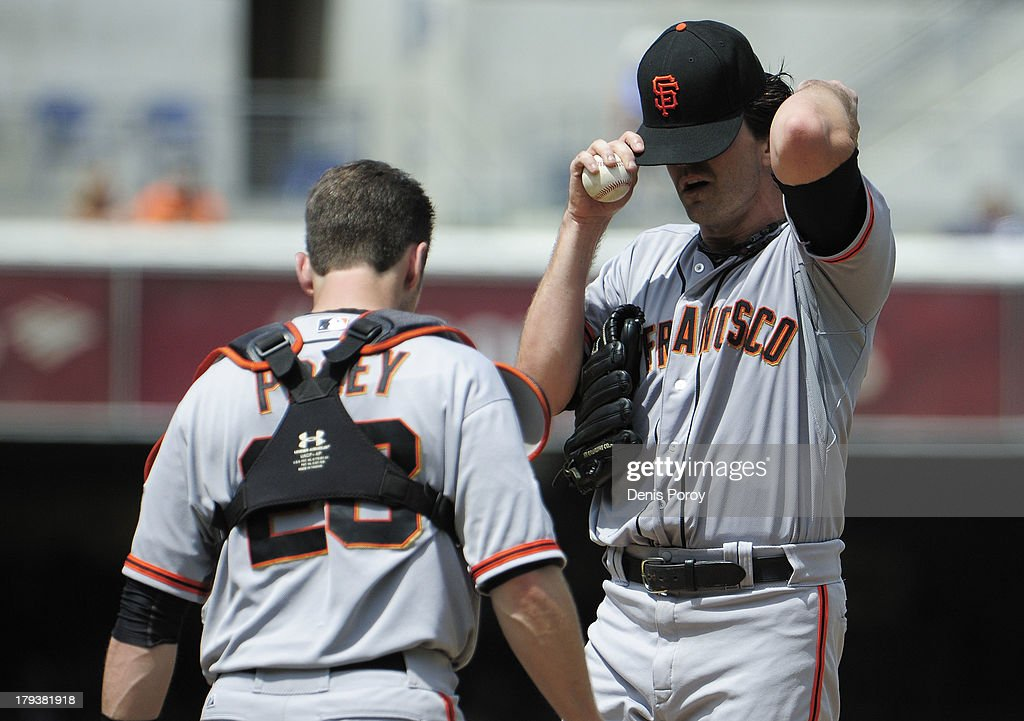 Pitcher <a gi-track='captionPersonalityLinkClicked' href=/galleries/search?phrase=Barry+Zito&family=editorial&specificpeople=202943 ng-click='$event.stopPropagation()'>Barry Zito</a> #75 of the San Francisco Giants wipes his face near catcher <a gi-track='captionPersonalityLinkClicked' href=/galleries/search?phrase=Buster+Posey&family=editorial&specificpeople=4896435 ng-click='$event.stopPropagation()'>Buster Posey</a> #28 a after giving up a home run during the fourth inning of a baseball game against the San Diego Padres at Petco Park on September 2, 2013 in San Diego, California. The Padres won 4-1.