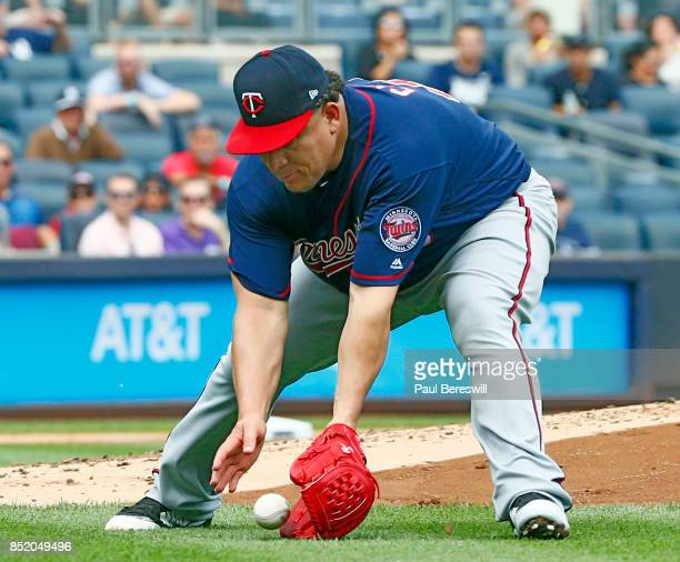 Pitcher Bartolo Colon fields a slow grounder and throws out Gary Sanchez at first base in an MLB baseball game against the New York Yankees on...