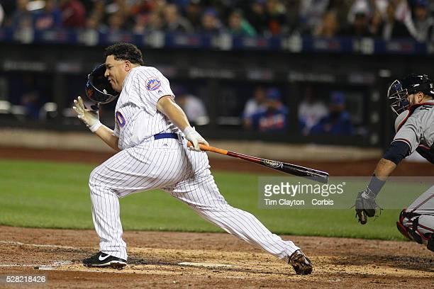 Pitcher Bartolo Colon of the New York Mets loses his helmet while batting during the Atlanta Braves Vs New York Mets MLB regular season game at Citi...
