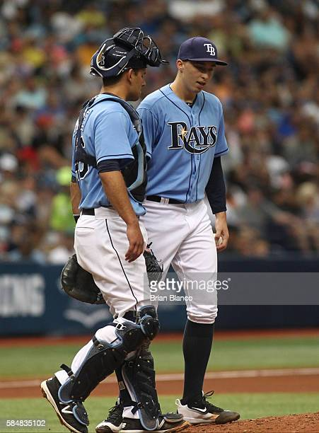Pitcher Blake Snell of the Tampa Bay Rays has a conversation on the mound with catcher Luke Maile after allowing a single by Chase Headley of the New...