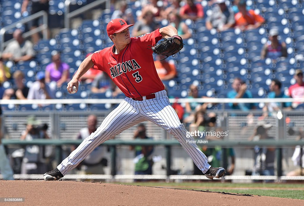 Pitcher Bobby Dalbec #3 of the Arizona Wildcats delivers a pitch against the Coastal Carolina Chanticleers in the first inning during game three of the College World Series Championship Series on June 30, 2016 at TD Ameritrade Park in Omaha, Nebraska.