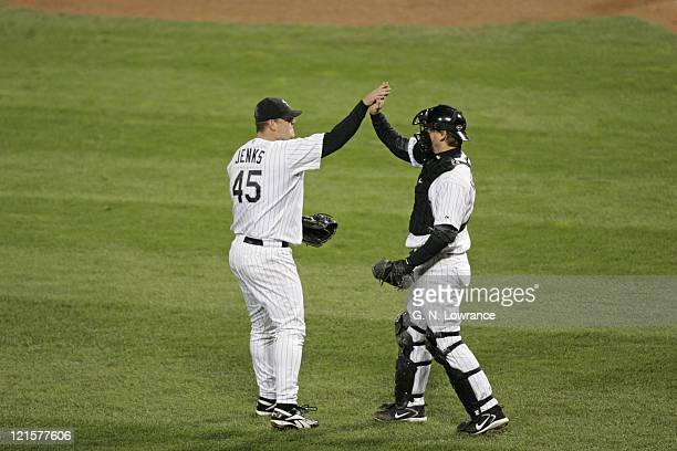 Pitcher Bobby Jenks is congratulated by AJ Pierzynski of the Chicago White Sox after winning game 1 of the World Series against the Houston Astros at...
