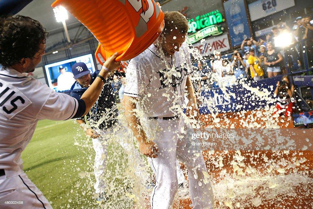 Pitcher Brad Boxberger #26 of the Tampa Bay Rays gets doused with sports drink by teammates <a gi-track='captionPersonalityLinkClicked' href=/galleries/search?phrase=David+DeJesus&family=editorial&specificpeople=206765 ng-click='$event.stopPropagation()'>David DeJesus</a> #7, left, and <a gi-track='captionPersonalityLinkClicked' href=/galleries/search?phrase=Steven+Souza+-+Baseball+player&family=editorial&specificpeople=12493609 ng-click='$event.stopPropagation()'>Steven Souza</a> Jr. #20 following the Rays' 3-1 win over the Houston Astros on July 10, 2015 at Tropicana Field in St. Petersburg, Florida.