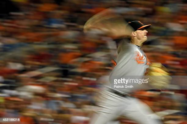 Pitcher Brad Brach of the Baltimore Orioles works the eighth inning against the Washington Nationals at Nationals Park on August 4 2014 in Washington...