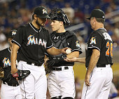 Pitcher Brad Hand of the Miami Marlins is taken out by Manager Dan Jennings against the New york Mets during the second inning at Marlins Park on...