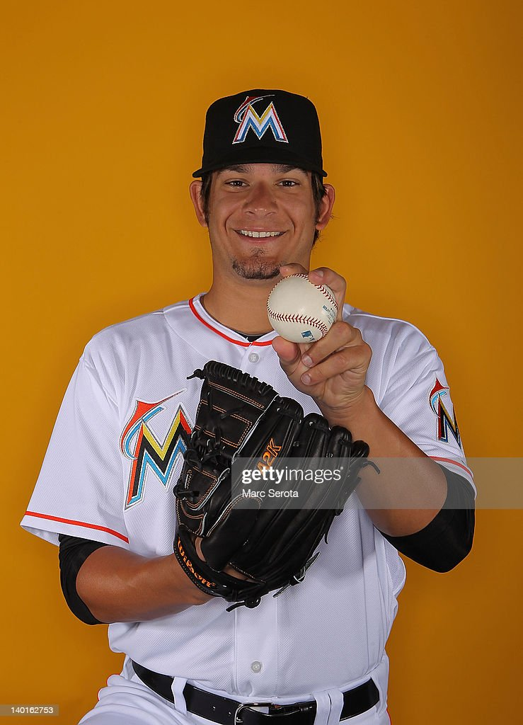 Pitcher Brad Hand #52 of the Miami Marlins poses for photos during media day on February 27, 2012 in Jupiter, Florida.