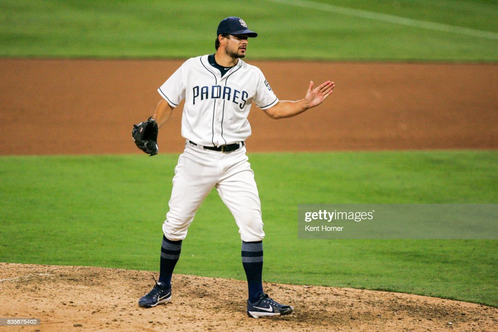 Pitcher Brad Hand #52 of the San Diego Padres reacts after recording the save during the 9th inning against the Washington Nationals at PETCO Park on August 19, 2017 in San Diego, California.
