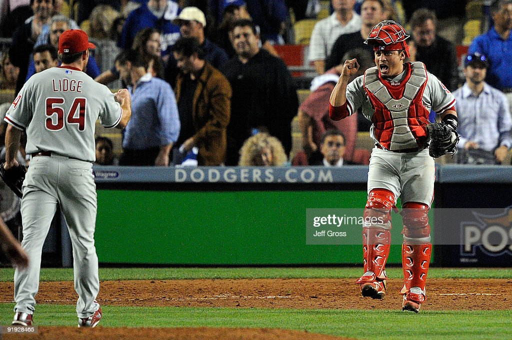 Pitcher Brad Lidge and catcher Carlos Ruiz of the Philadelphia Phillies celebrate after closing the game against the Los Angeles Dodgers in Game One...