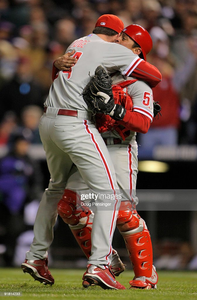 Pitcher <a gi-track='captionPersonalityLinkClicked' href=/galleries/search?phrase=Brad+Lidge&family=editorial&specificpeople=208188 ng-click='$event.stopPropagation()'>Brad Lidge</a> #54 of the Philadelphia Phillies celebrates with catcher <a gi-track='captionPersonalityLinkClicked' href=/galleries/search?phrase=Carlos+Ruiz+-+Baseball+Player&family=editorial&specificpeople=216605 ng-click='$event.stopPropagation()'>Carlos Ruiz</a> #51 after the final out against the Colorado Rockies in Game 4 of their National League Divisional Series at Coors Field on October 12, 2009 in Denver, Colorado. The Phillies defeated the Rockies 5-4 and clinched the series and a trip to the National League Championship to face the Los Angeles Dodgers.