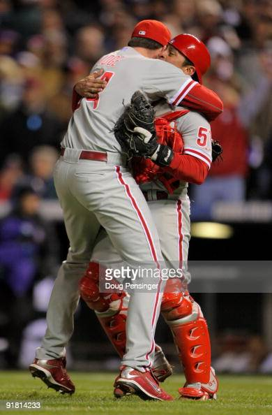 Pitcher Brad Lidge of the Philadelphia Phillies celebrates with catcher Carlos Ruiz after the final out against the Colorado Rockies in Game 4 of...