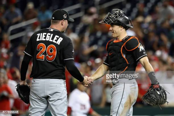 Pitcher Brad Ziegler and catcher JT Realmuto of the Miami Marlins celebrate the Marlins 73 win over the Washington Nationals at Nationals Park on...