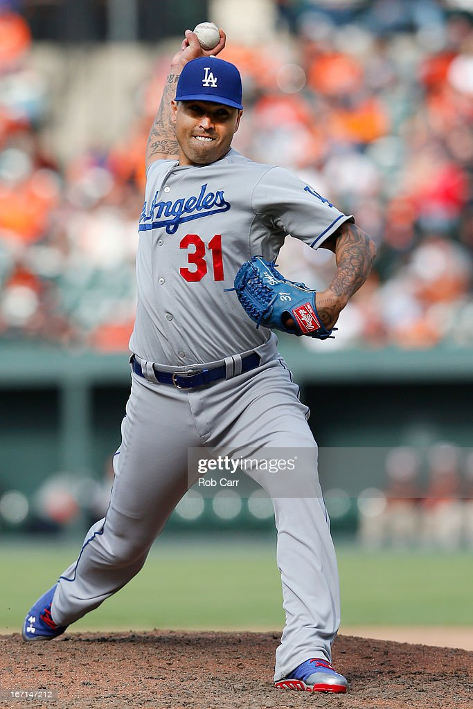 Pitcher <a gi-track='captionPersonalityLinkClicked' href=/galleries/search?phrase=Brandon+League&family=editorial&specificpeople=809191 ng-click='$event.stopPropagation()'>Brandon League</a> #31 of the Los Angeles Dodgers throws to a Baltimore Orioles batter during the ninth inning of the Dodgers 7-4 win at Oriole Park at Camden Yards on April 21, 2013 in Baltimore, Maryland.