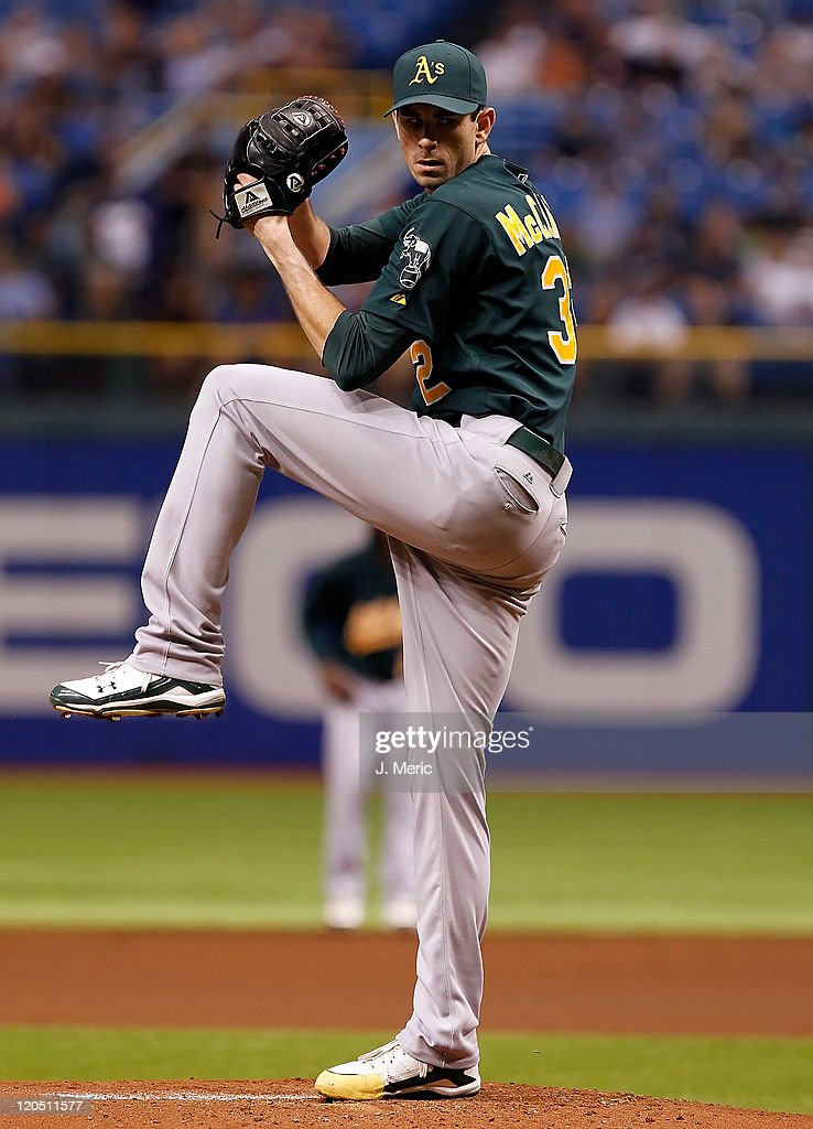 Pitcher <a gi-track='captionPersonalityLinkClicked' href=/galleries/search?phrase=Brandon+McCarthy&family=editorial&specificpeople=224849 ng-click='$event.stopPropagation()'>Brandon McCarthy</a> #32 of the Oakland Athletics pitches against the Tampa Bay Rays during the game at Tropicana Field on August 6, 2011 in St. Petersburg, Florida.