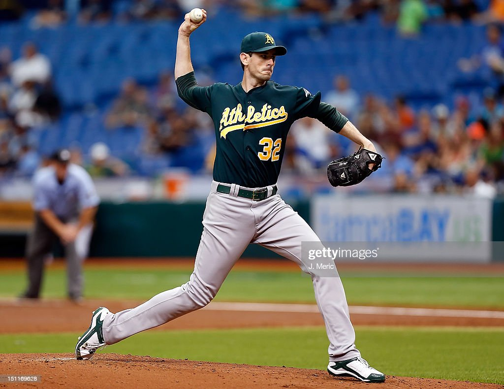 Pitcher <a gi-track='captionPersonalityLinkClicked' href=/galleries/search?phrase=Brandon+McCarthy&family=editorial&specificpeople=224849 ng-click='$event.stopPropagation()'>Brandon McCarthy</a> #32 of the Oakland Athletics pitches against the Tampa Bay Rays during the game at Tropicana Field on August 25, 2012 in St. Petersburg, Florida.