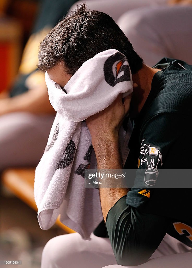 Pitcher <a gi-track='captionPersonalityLinkClicked' href=/galleries/search?phrase=Brandon+McCarthy&family=editorial&specificpeople=224849 ng-click='$event.stopPropagation()'>Brandon McCarthy</a> #32 of the Oakland Athletics relaxes on the bench during the game against the Tampa Bay Rays at Tropicana Field on August 6, 2011 in St. Petersburg, Florida.