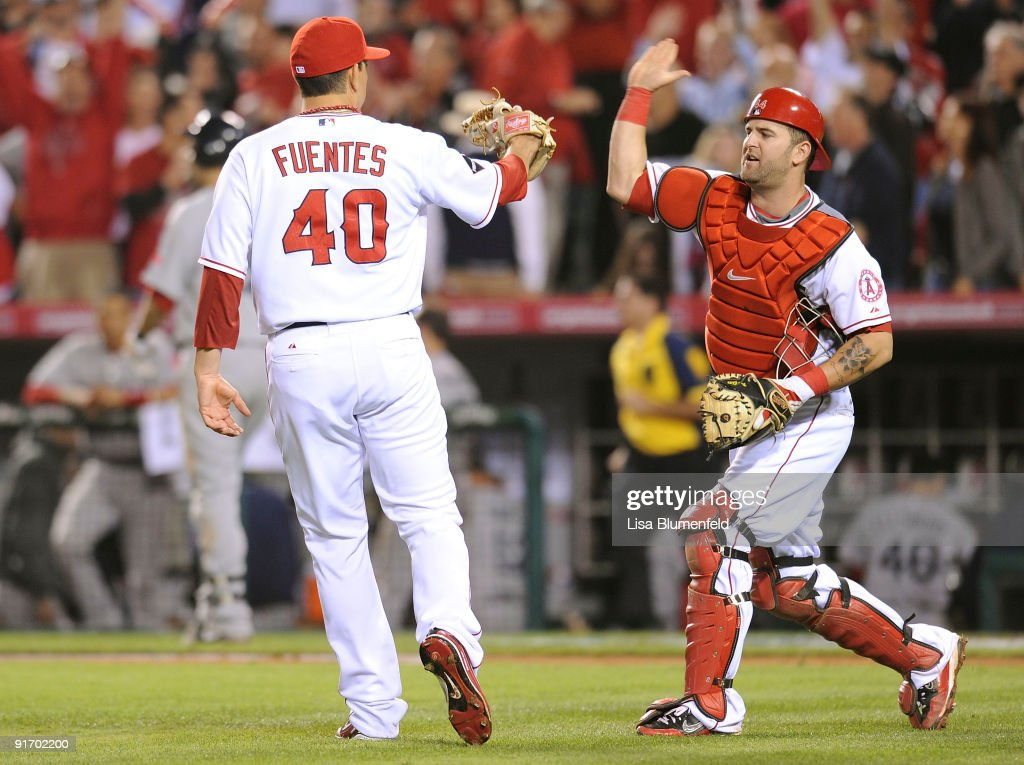 Pitcher Brian Fuentes#40 and catcher and Mike Napoli #44 of the Los Angeles Angels of Anaheim celebrate the 4-1 win over the Boston Red Sox in Game Two of the ALDS during the 2009 MLB Playoffs at Angel Stadium on October 9, 2009 in Anaheim, California.