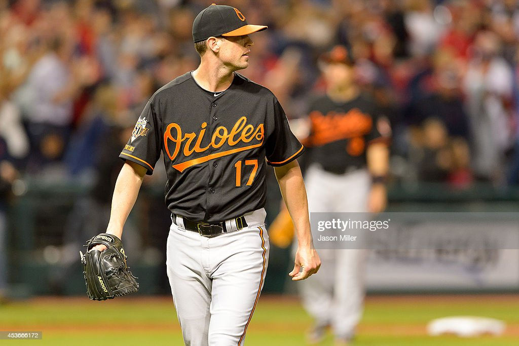 Pitcher Brian Matusz #17 of the Baltimore Orioles reacts after giving up the game winning home run to Mike Aviles #4 of the Cleveland Indians during the eleventh inning at Progressive Field on August 15, 2014 in Cleveland, Ohio. The Indians defeated the Orioles 2-1 in 11 innings.
