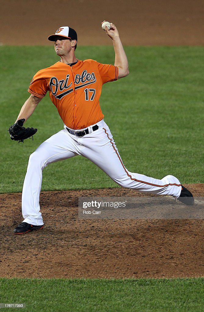 Pitcher <a gi-track='captionPersonalityLinkClicked' href=/galleries/search?phrase=Brian+Matusz&family=editorial&specificpeople=4412757 ng-click='$event.stopPropagation()'>Brian Matusz</a> #17 of the Baltimore Orioles throws to a Colorado Rockies batter during the seventh inning of the Orioles 8-4 win at Oriole Park at Camden Yards on August 17, 2013 in Baltimore, Maryland.