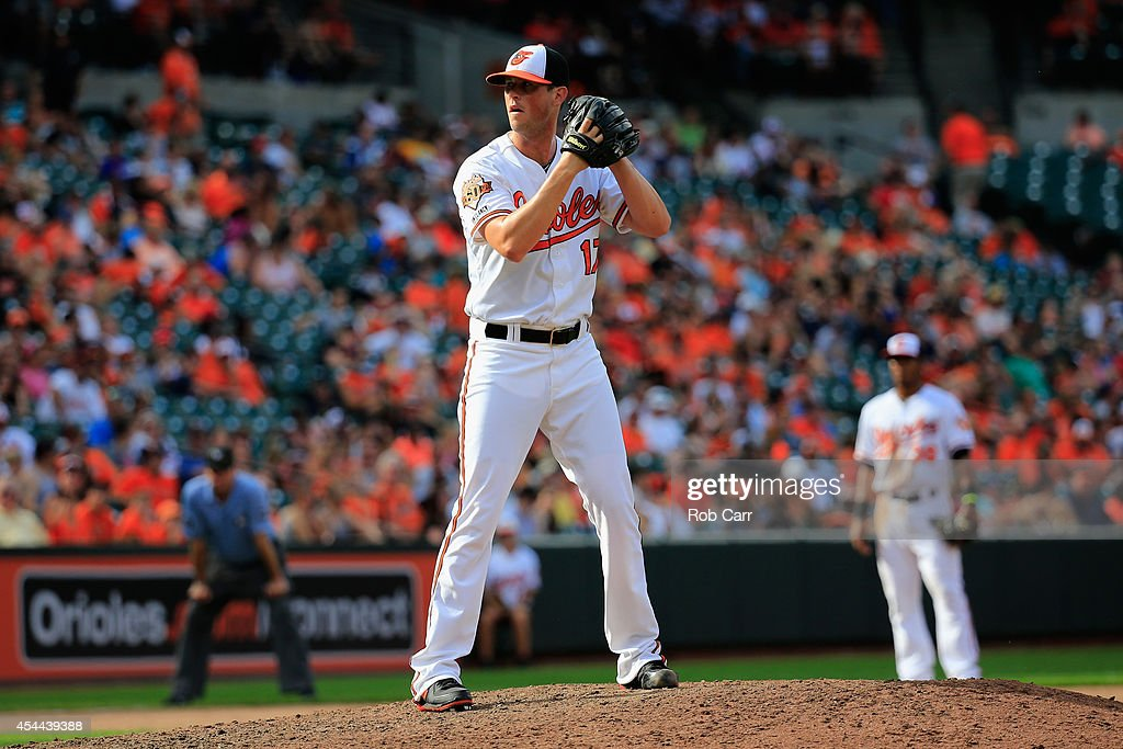 Pitcher Brian Matusz #17 of the Baltimore Orioles throws to a Minnesota Twins batter during the ninth inning at Oriole Park at Camden Yards on August 31, 2014 in Baltimore, Maryland.