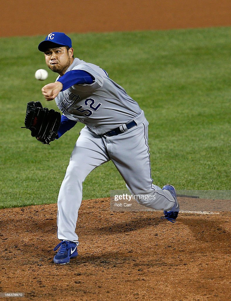 Pitcher <a gi-track='captionPersonalityLinkClicked' href=/galleries/search?phrase=Bruce+Chen&family=editorial&specificpeople=213886 ng-click='$event.stopPropagation()'>Bruce Chen</a> #52 of the Kansas City Royals throws to a Baltimore Orioles batter during the eighth inning of the Orioles 5-3 win at Oriole Park at Camden Yards on May 8, 2013 in Baltimore, Maryland.