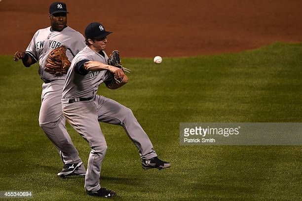 Pitcher Bryan Mitchell of the New York Yankees cannot make a play on Jimmy Paredes of the Baltimore Orioles in the fifth inning during game two of a...