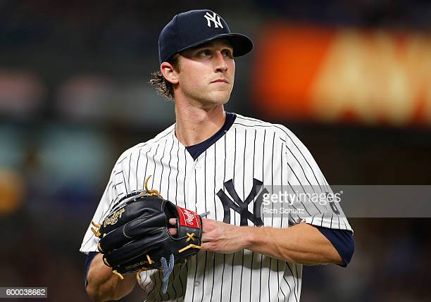 Pitcher Bryan Mitchell of the New York Yankees walks off the mound after being relieved in the sixth inning against the Toronto Blue Jays during a...