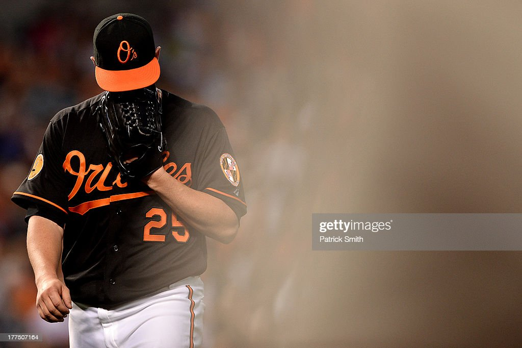 Pitcher <a gi-track='captionPersonalityLinkClicked' href=/galleries/search?phrase=Bud+Norris&family=editorial&specificpeople=5746311 ng-click='$event.stopPropagation()'>Bud Norris</a> #25 of the Baltimore Orioles walks to the dugout after giving up two home runs in the third inning against the Oakland Athletics at Oriole Park at Camden Yards on August 23, 2013 in Baltimore, Maryland.