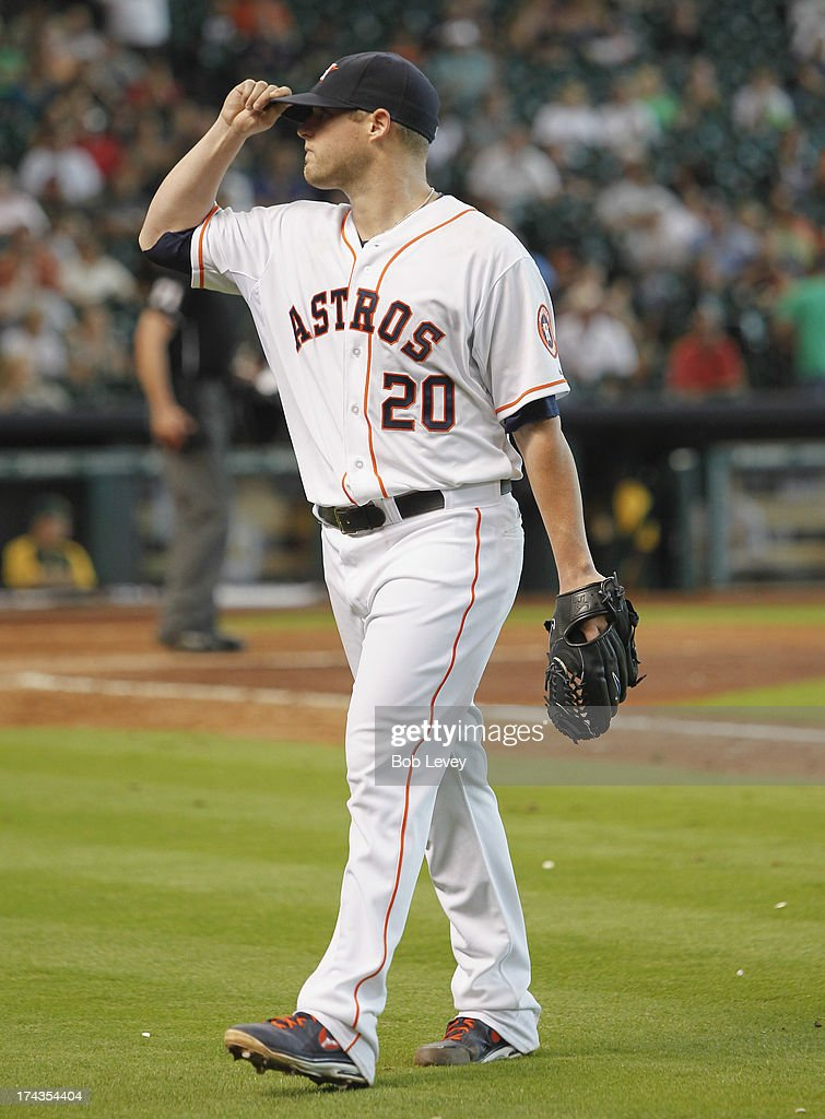 Pitcher Bud Norris #20 of the Houston Astros tips his hat to the crowd as he leaves the game in the seventh inning against the Oakland Athletics at Minute Maid Park on July 24, 2013 in Houston, Texas.