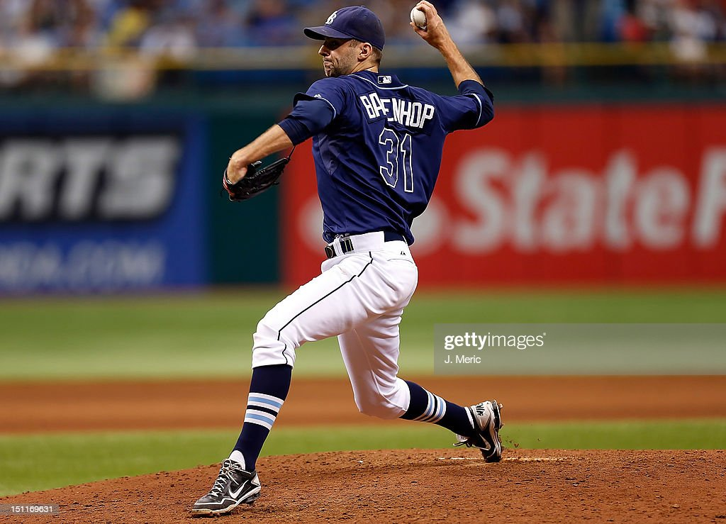 Pitcher <a gi-track='captionPersonalityLinkClicked' href=/galleries/search?phrase=Burke+Badenhop&family=editorial&specificpeople=4901342 ng-click='$event.stopPropagation()'>Burke Badenhop</a> #31 of the Tampa Bay Rays pitches against the Oakland Athletics during the game at Tropicana Field on August 25, 2012 in St. Petersburg, Florida.