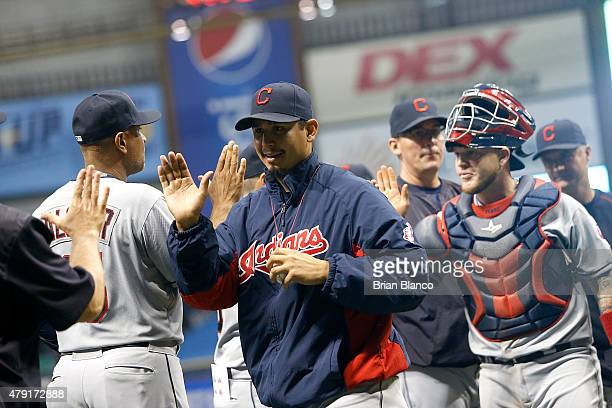 Pitcher Carlos Carrasco of the Cleveland Indians celebrates with teammates following a win against the Tampa Bay Rays on July 1 2015 at Tropicana...