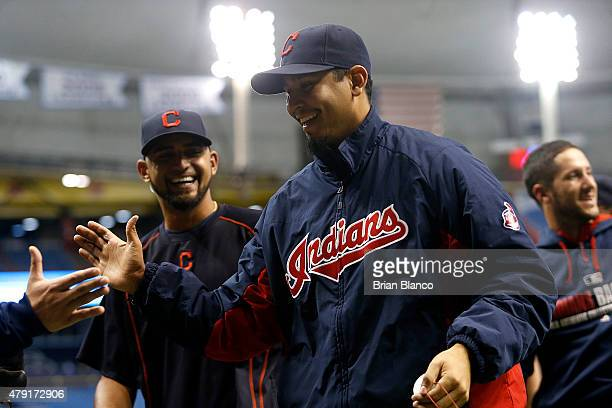 Pitcher Carlos Carrasco of the Cleveland Indians celebrates with teammates following a game against the Tampa Bay Rays on July 1 2015 at Tropicana...