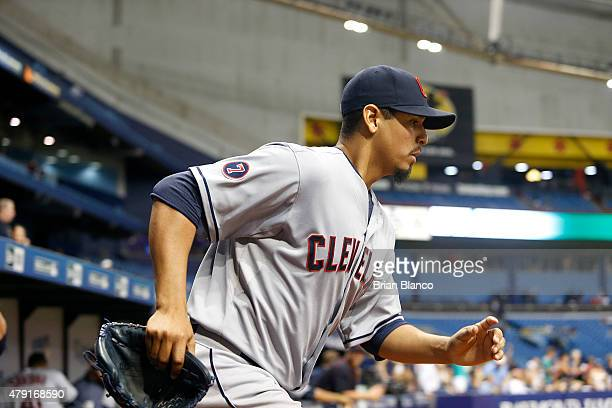 Pitcher Carlos Carrasco of the Cleveland Indians heads out to the mound to start the bottom of the seventh inning of a game against the Tampa Bay...