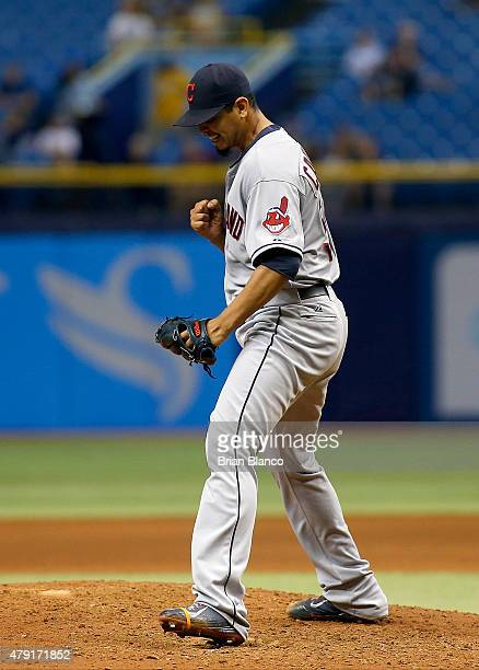 Pitcher Carlos Carrasco of the Cleveland Indians reacts on the mound after striking out Steven Souza Jr #20 of the Tampa Bay Rays to end the eighth...