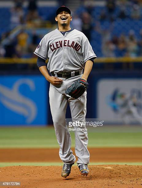 Pitcher Carlos Carrasco of the Cleveland Indians reacts on the mound after giving up a single to Joey Butler of the Tampa Bay Rays on a 02 count with...