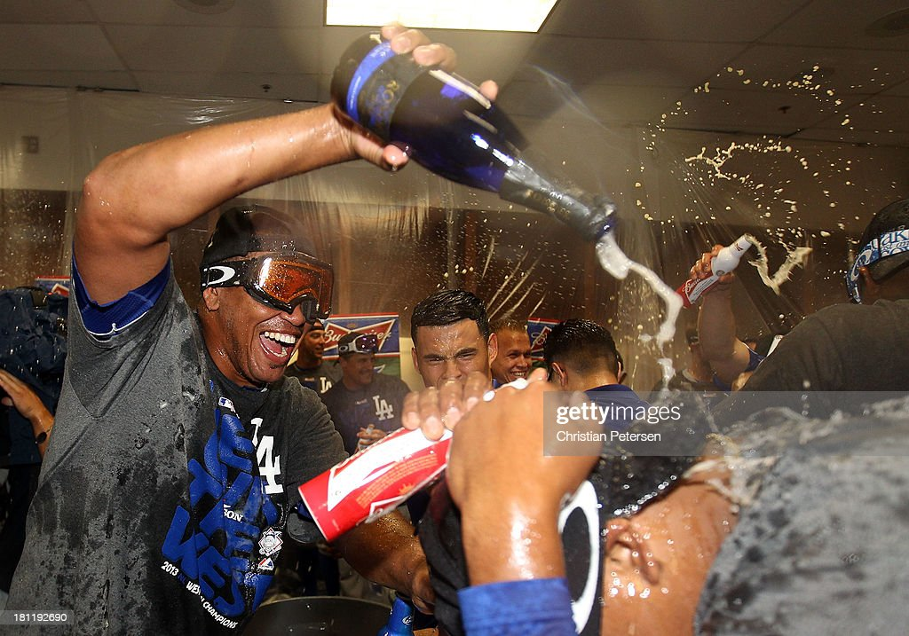 Pitcher Carlos Marmol #49 of the Los Angeles Dodgers celebrates in the locker room after defeating the Arizona Diamondbacks to clinch the National League West title and a postseason berth at Chase Field on September 19, 2013 in Phoenix, Arizona.